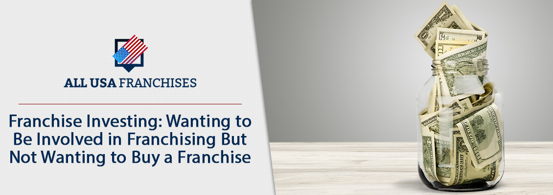 Glass Cointaining Money to Invest in Franchising