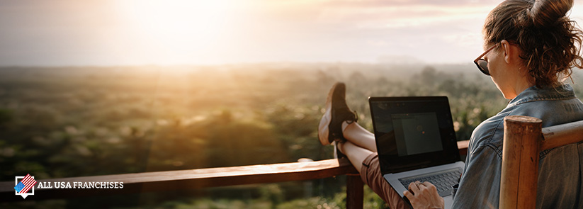 Online franchise owner working with a beautiful view