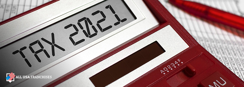 Red Calculator That Reads Tax 2020 on Its Screen